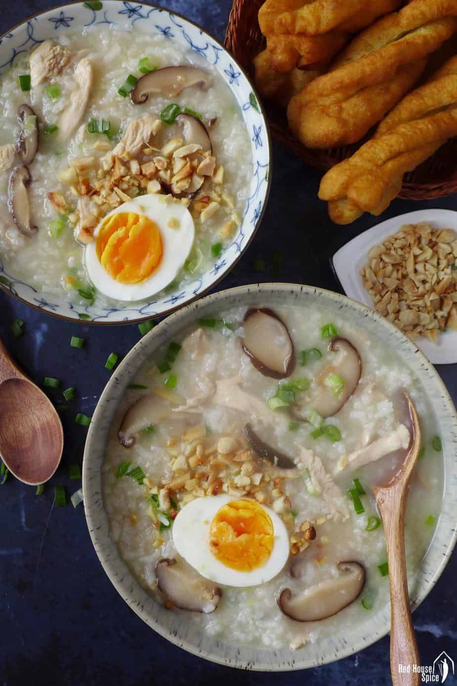 two bowls of congee with chicken & mushroom