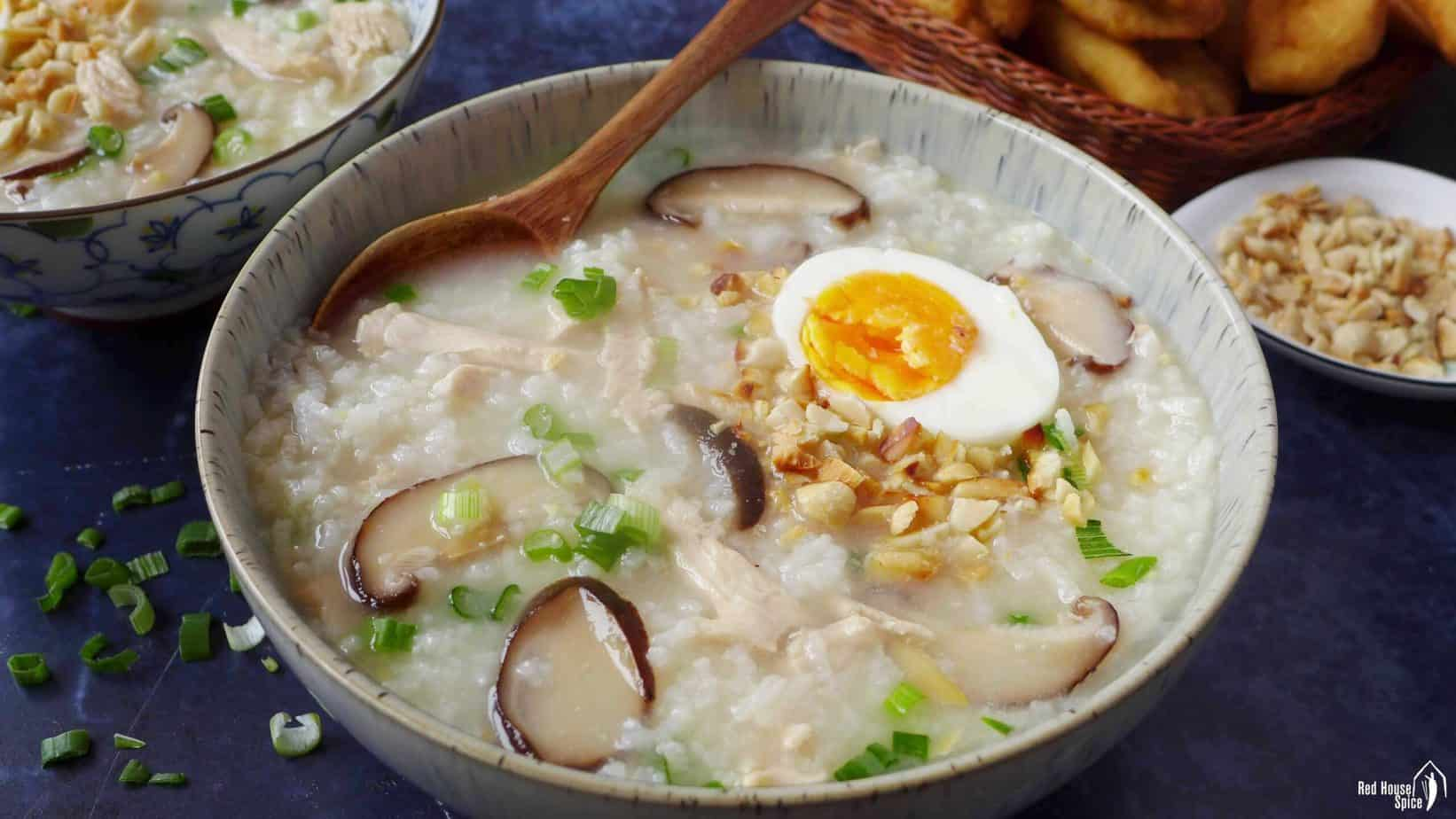 Chinese congee with chicken, egg and mushroom