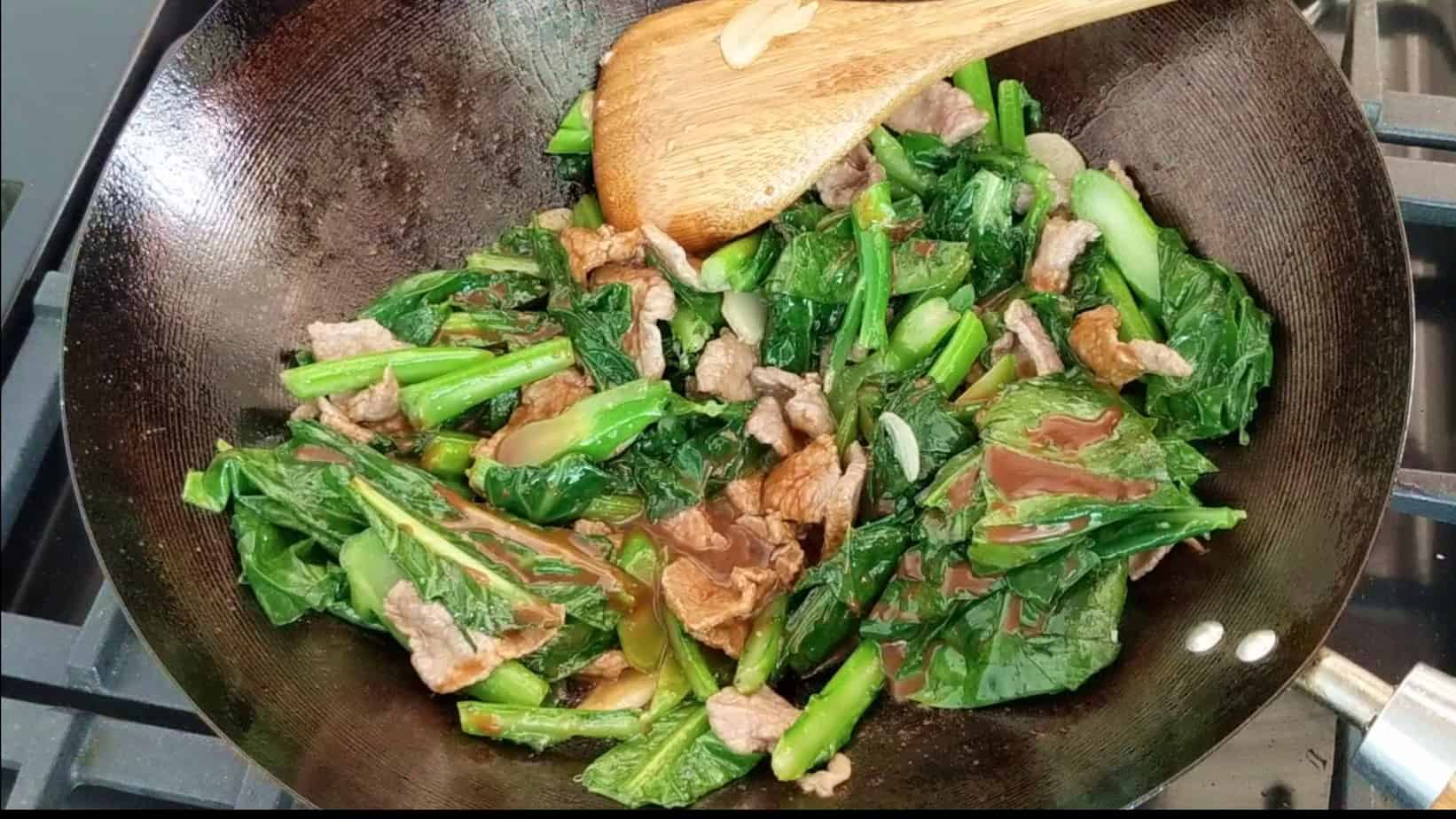 Beef & Chinese broccoli fried in a wok
