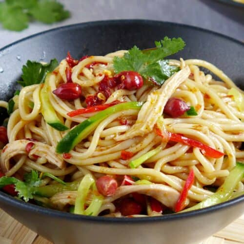 A bowl of cold noodles with a spicy dressing