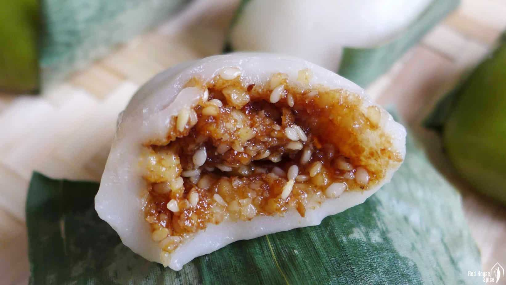 A sticky rice cake filled with walnuts & sesame seeds