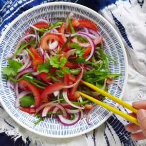 salad made of tomato, onion and coriander