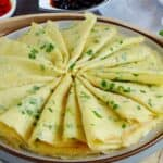 A plate of Chinese egg & scallion crepes