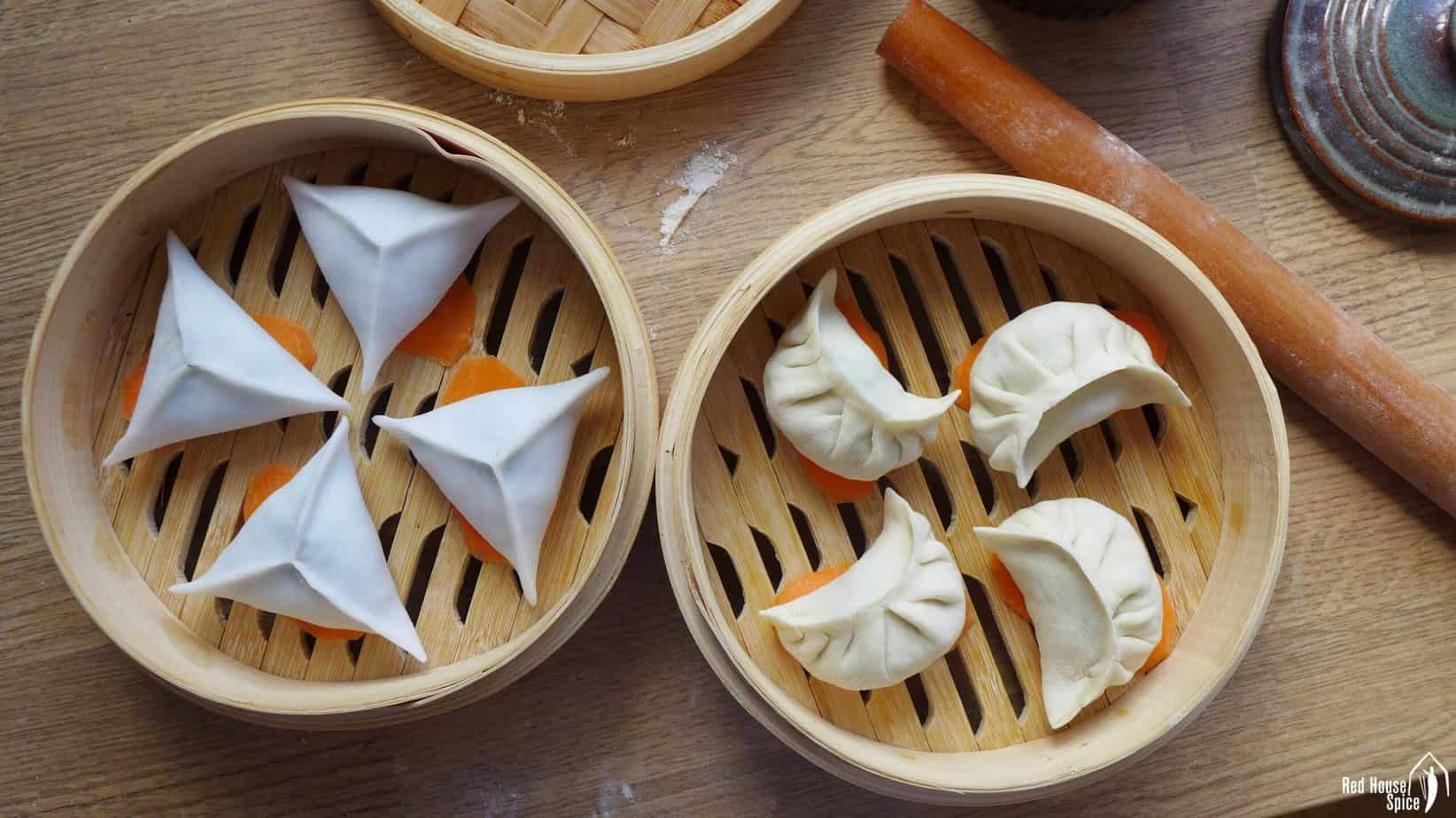Uncooked dumplings in bamboo steamers