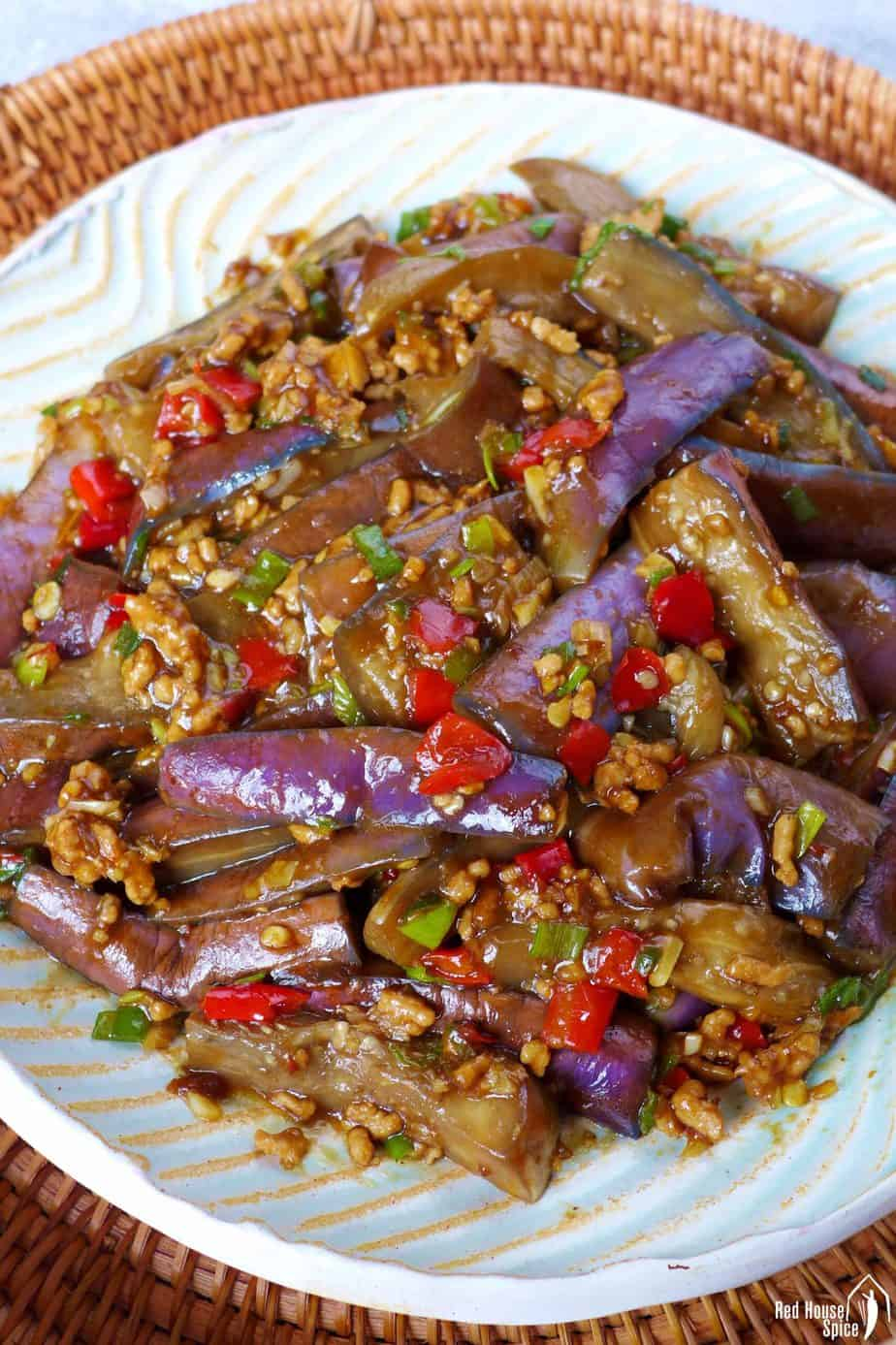 A plate of stir-fried eggplant with garlic sauce