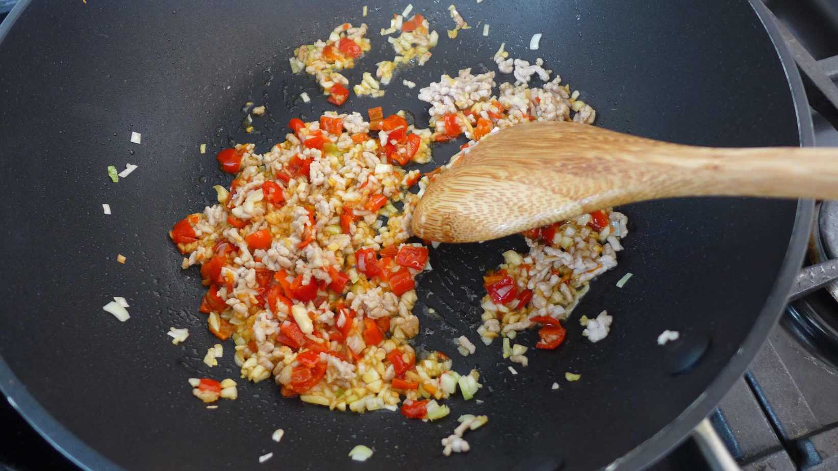 Stir frying minced meat and pickled chilli