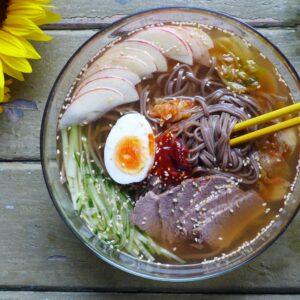 a bowl of cold soba noodles