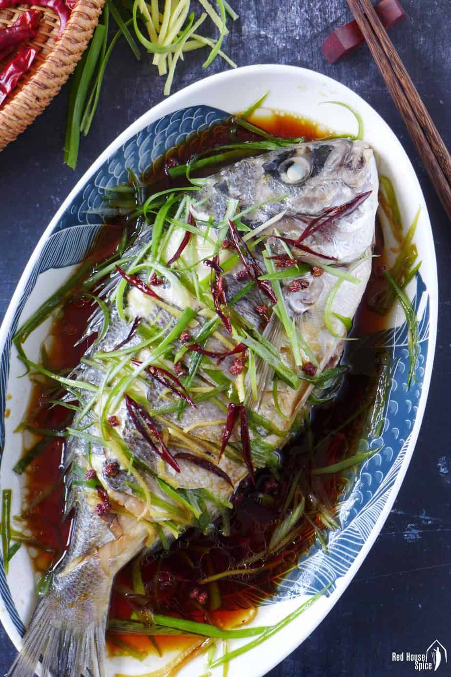 Chinese steamed fish in a plate