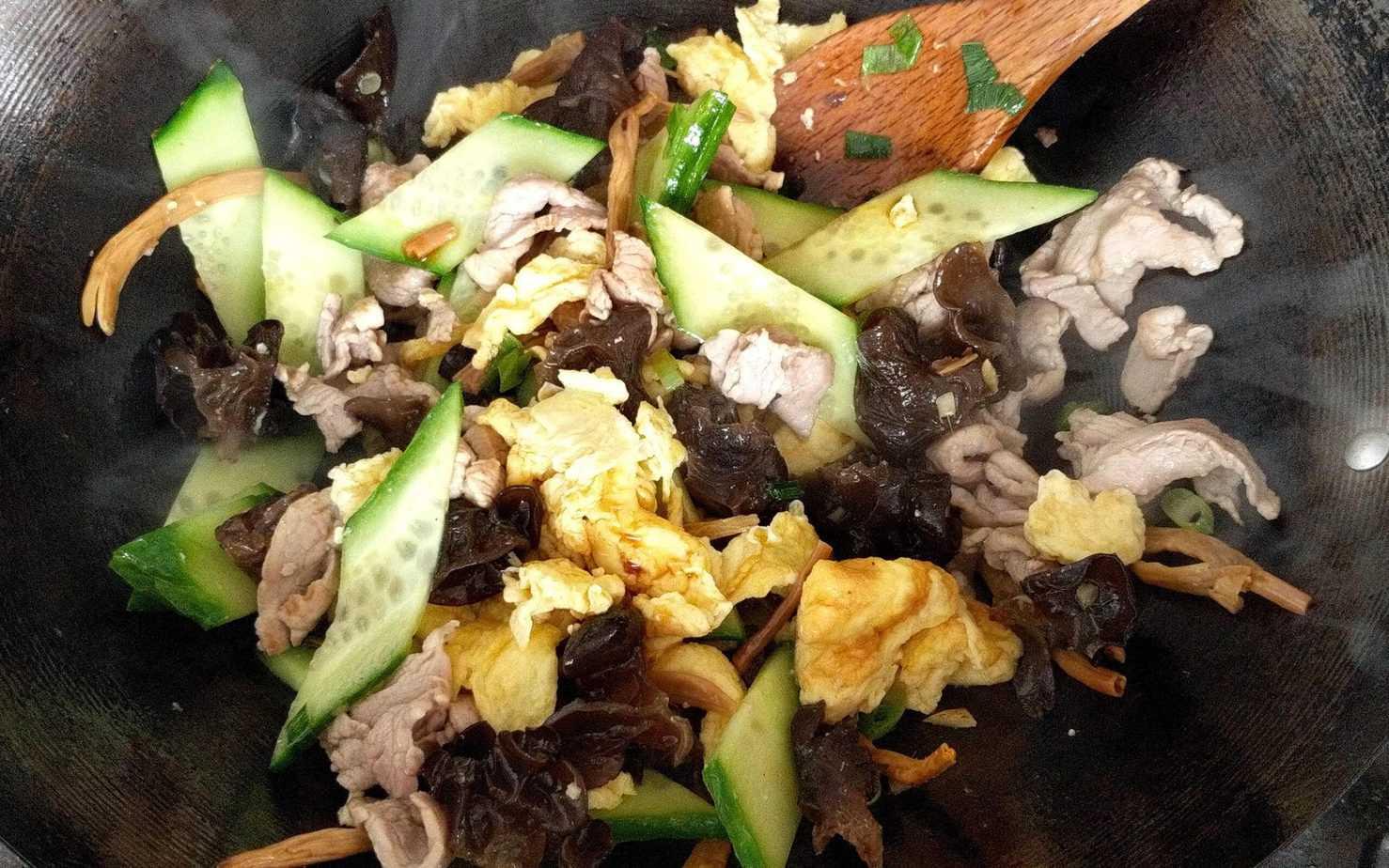 Cooking Moo Shu Pork in a wok