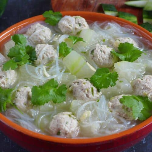 A pot of winter melon soup with meatballs and mung bean noodles