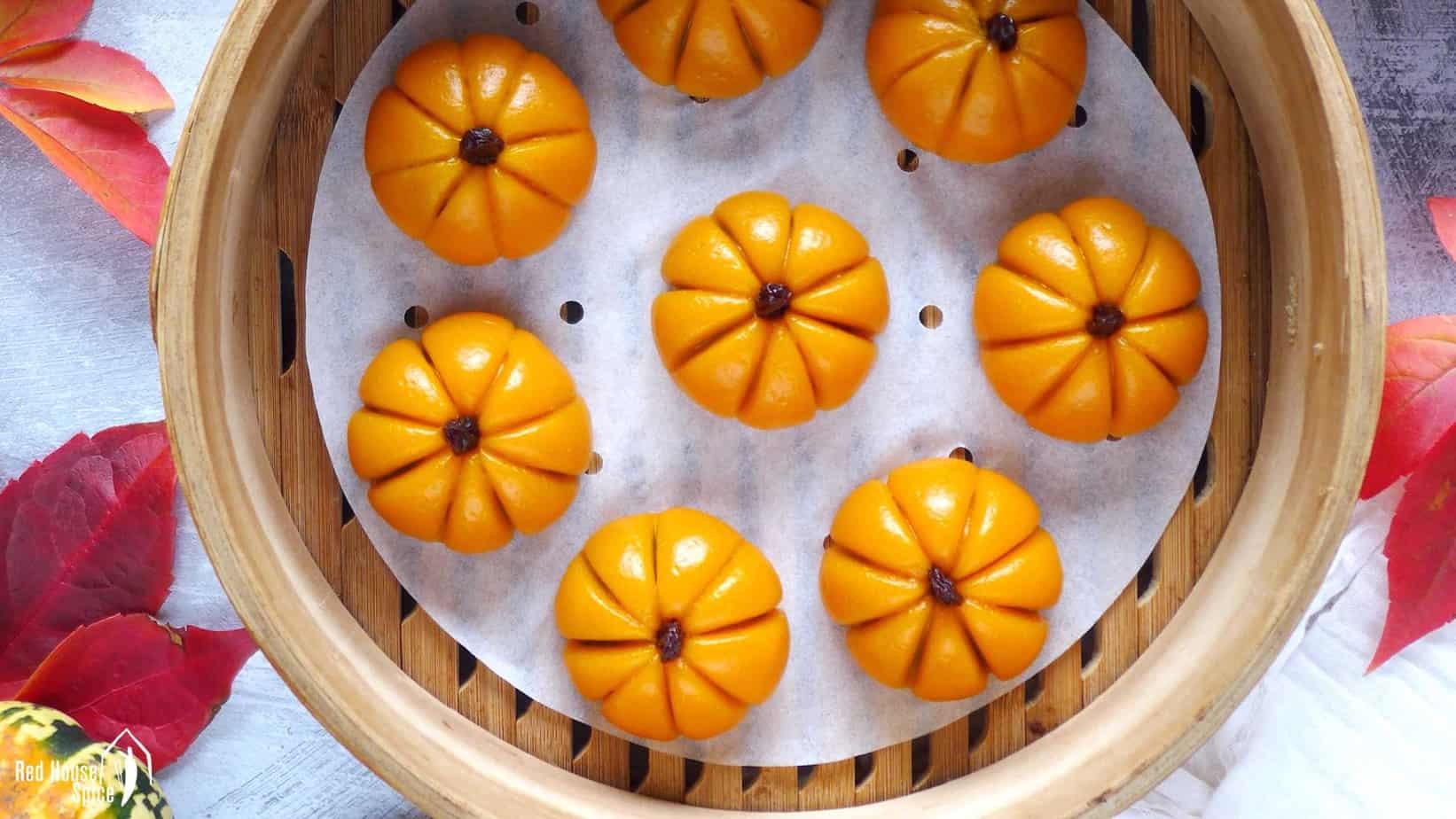 pumpkin shaped mochi cakes in a steamer.
