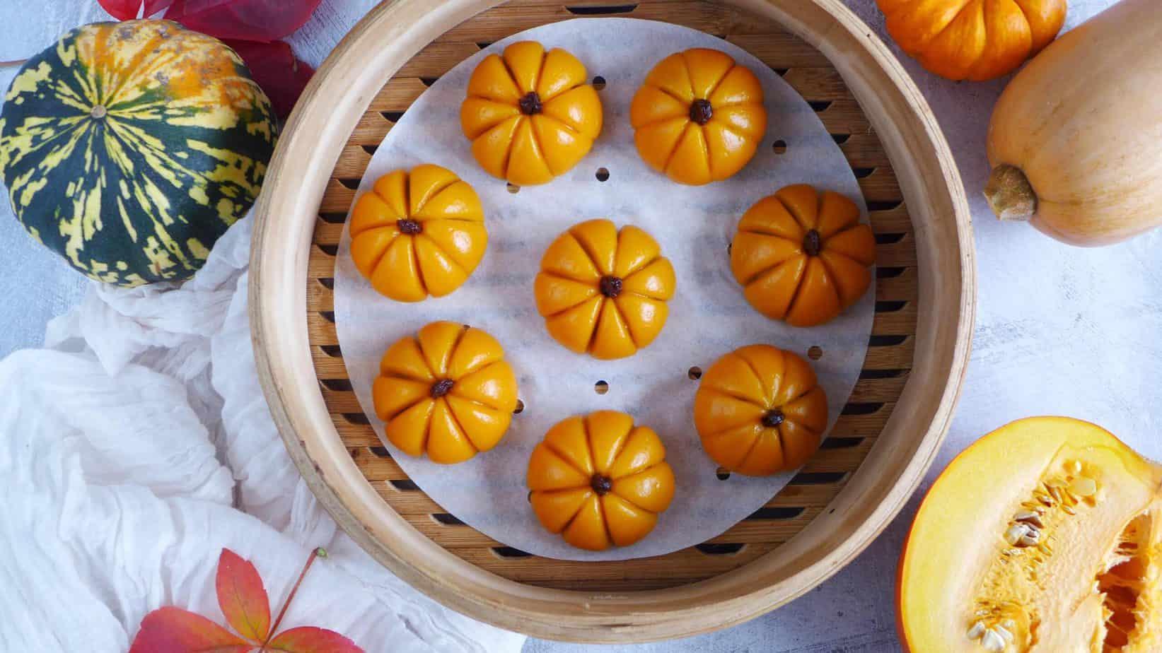 Eight pumpkin cakes in a steamer