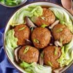 Six lion's head meatballs in a plate