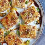 Pan fried turnip cake with soy sauce and chili oil