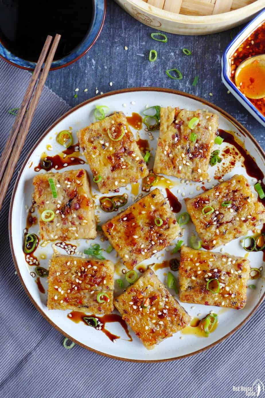 Pan-fried turnip cake with dressing in a plate