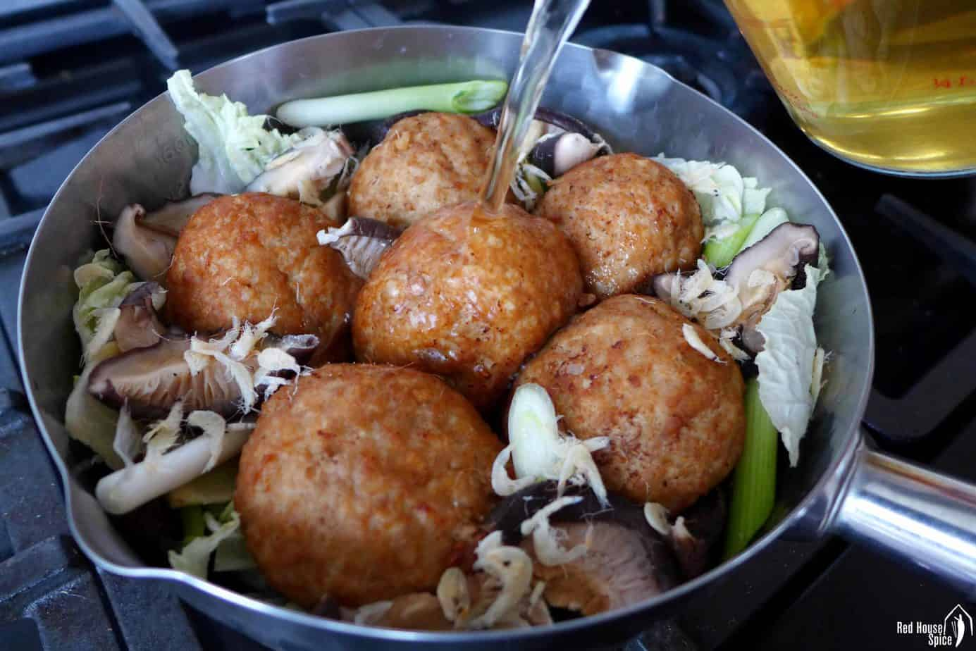 Cooking pork meatballs with cabbage and musroom