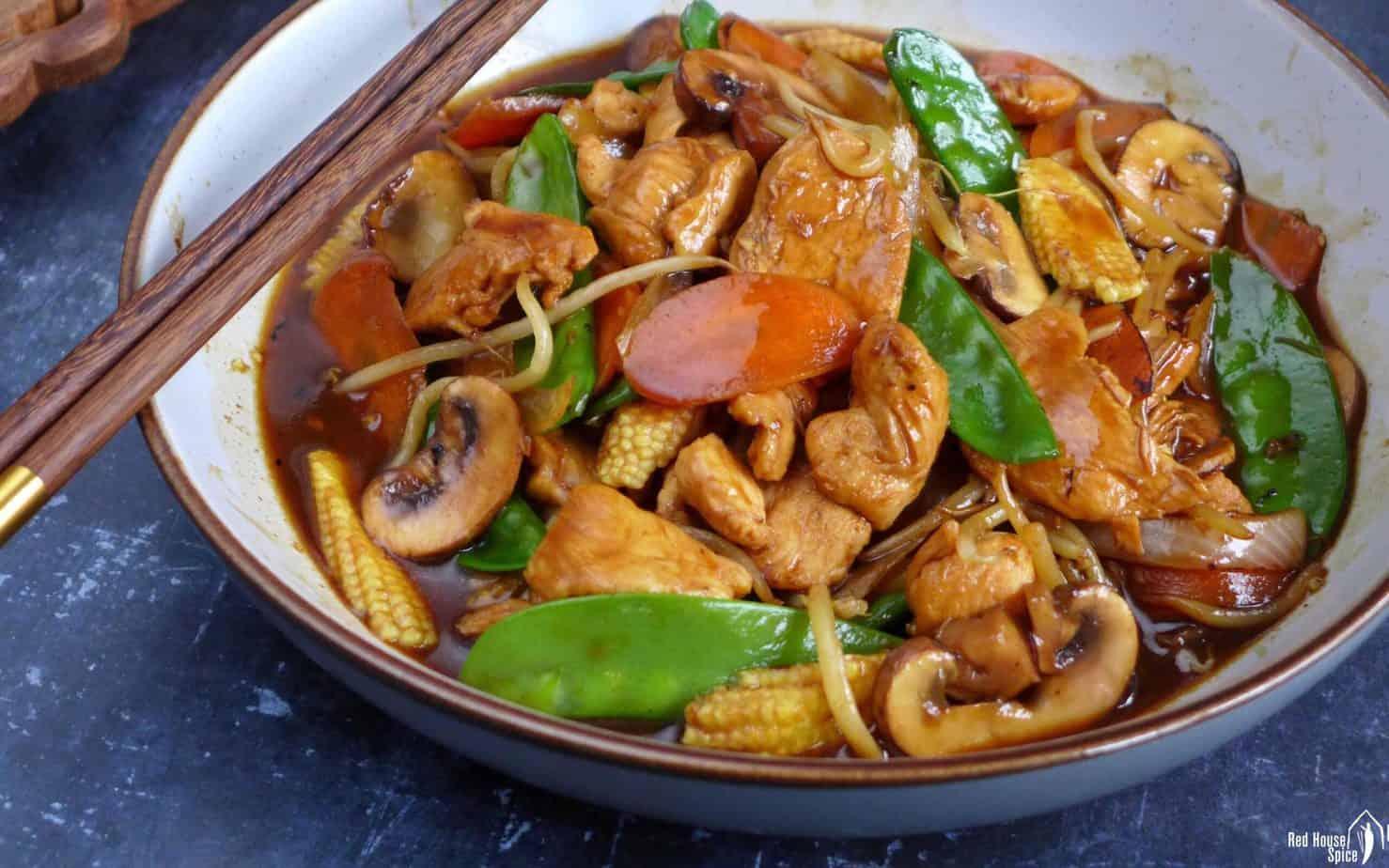 A plate of chicken chop suey