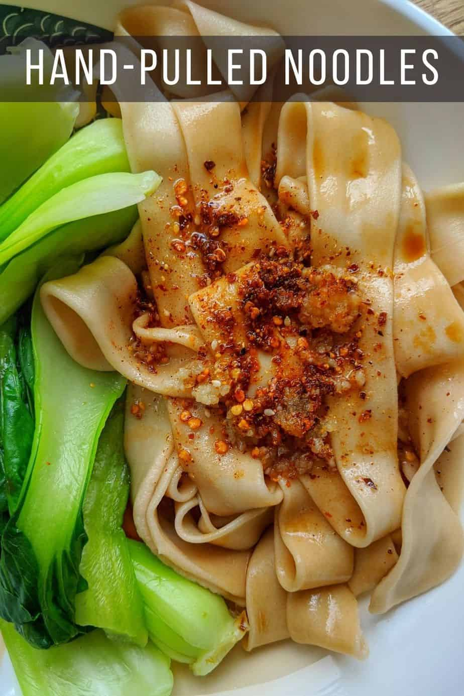 flat noodles with bok choy and spices