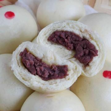 An open red bean bun