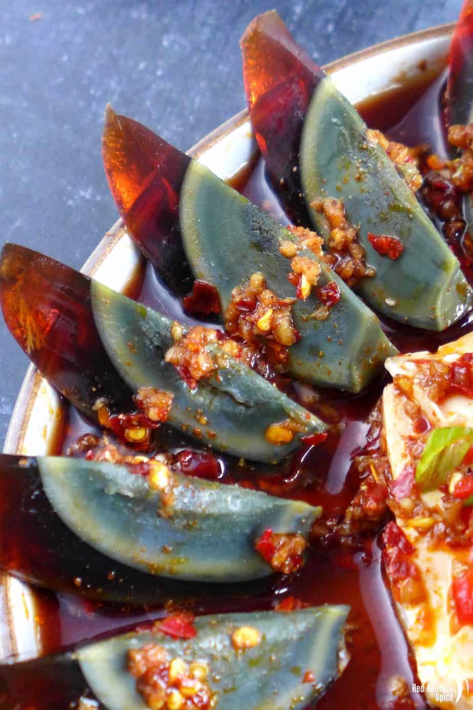 Century egg wedges in spicy dressing