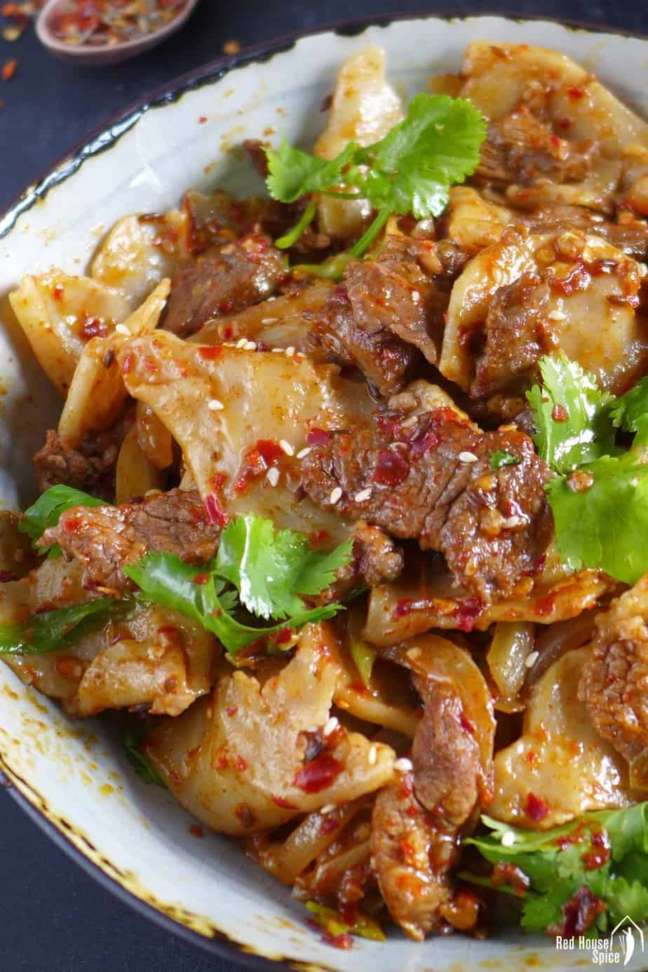 Hand-torn noodles mix with spicy lamb