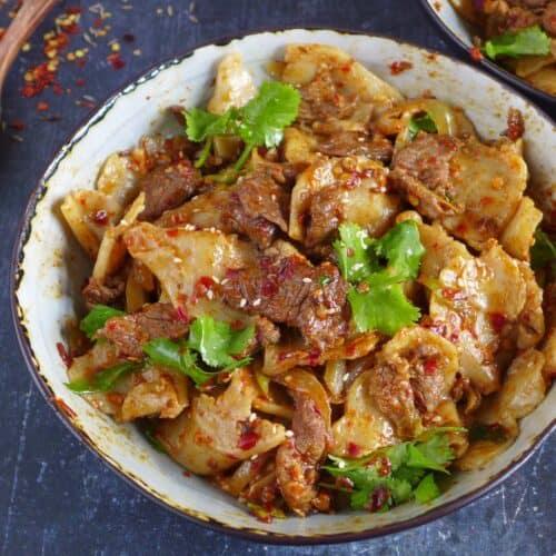 a bowl of spicy cumin lamb noodles