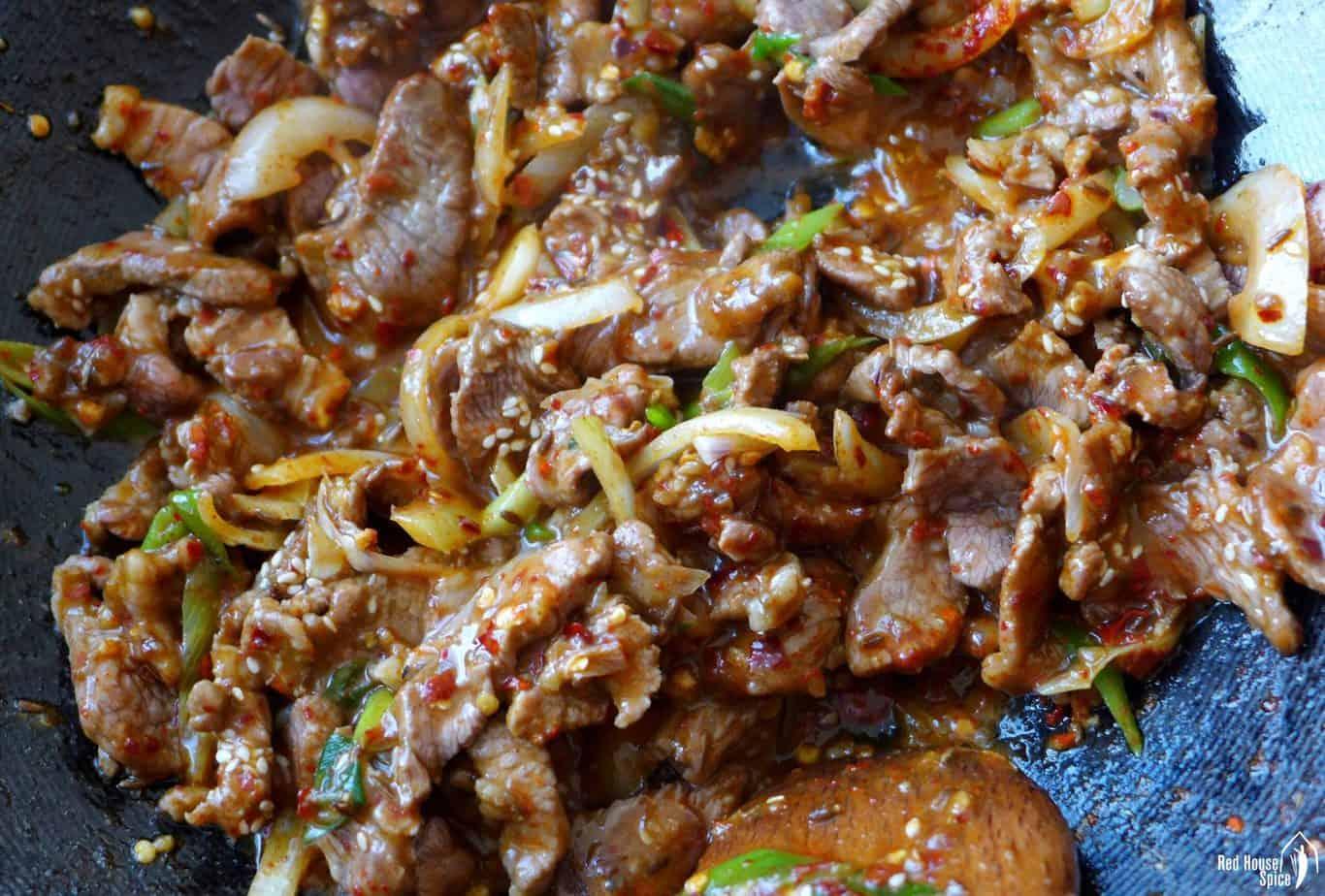 Stir-frying lamb