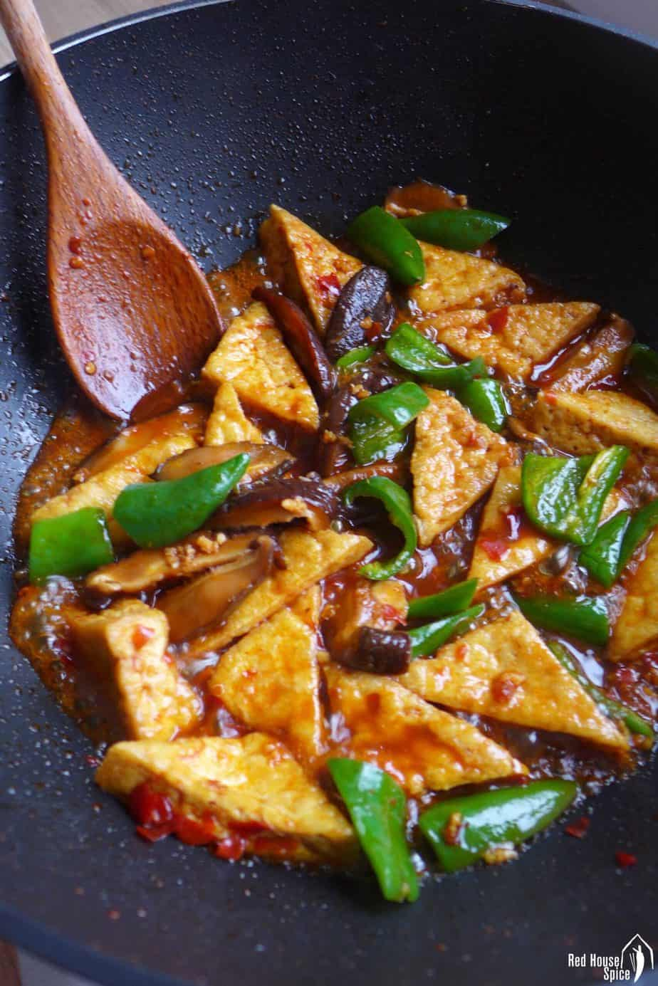 braising fried tofu in a wok