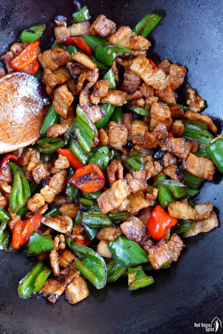 frying pork and chili in a wok