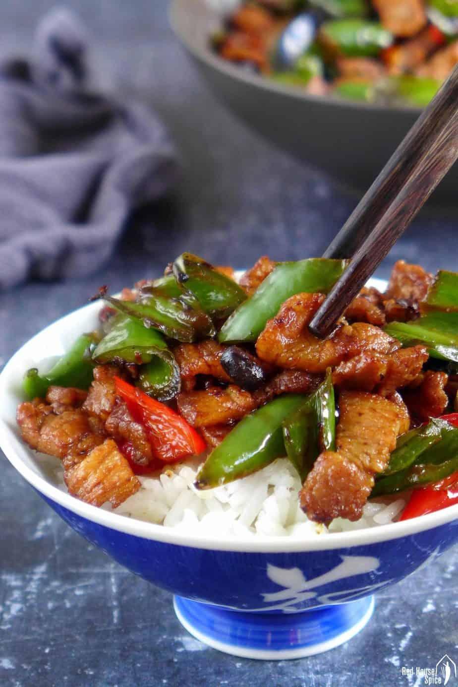 Chopsticks picking up Hunan pork