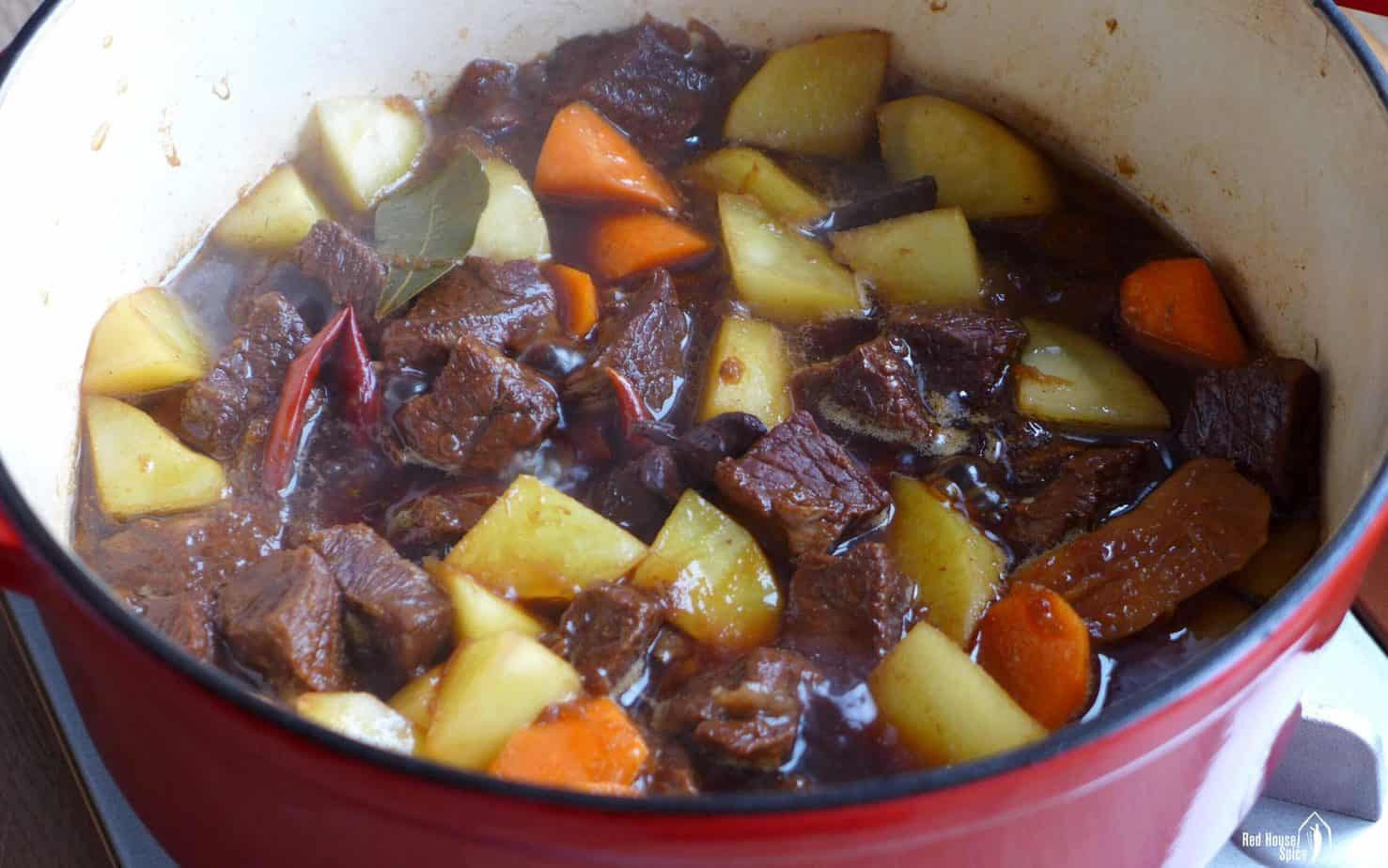 cooking beef and potato in a pot