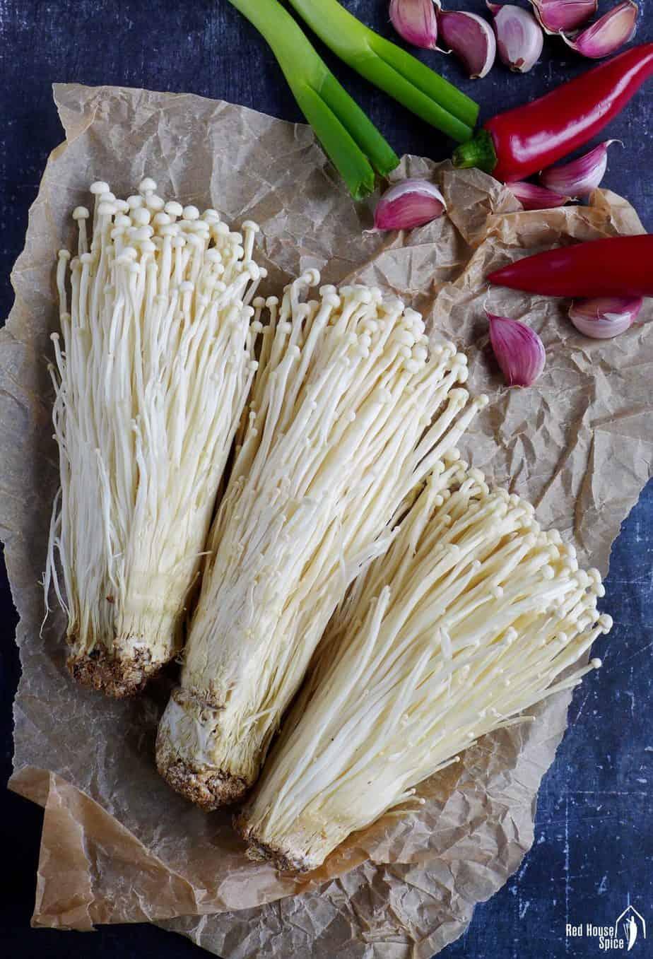raw enoki mushroom, garlic, chili and scallions