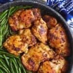 Spice seasoned chicken thighs with green beans