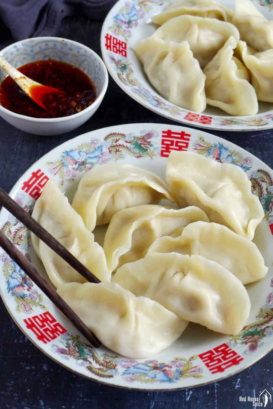 Chinese boiled pork dumplings and chili oil