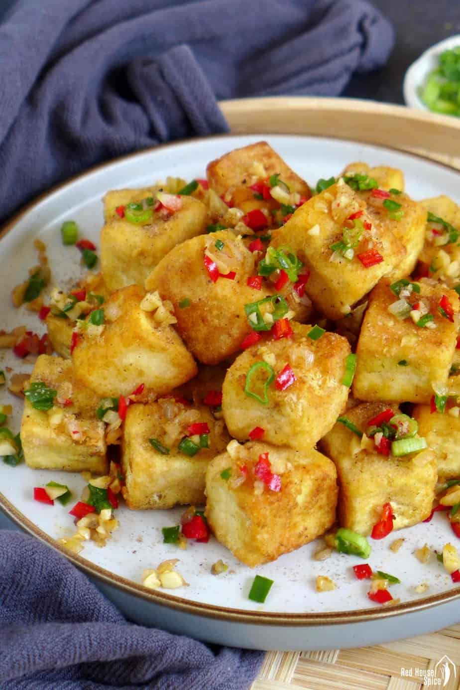 Salt and pepper tofu sprinkled with minced chili pepper, garlic and shallots