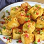 A plate of Chinese salt and pepper tofu with text overlay that says salt and pepper tofu.