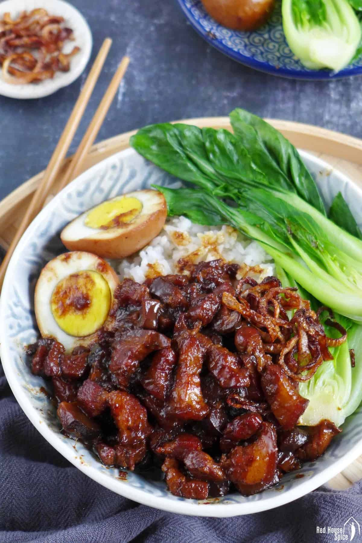 A bowl of Taiwanese Lu Rou Fan consisting of braised pork, hard boiled egg, Bok Choy and rice