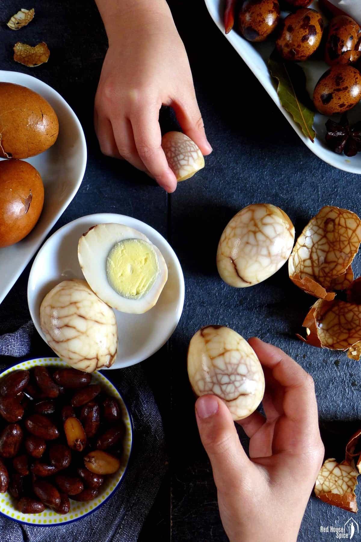 Marbled tea eggs held in two hands