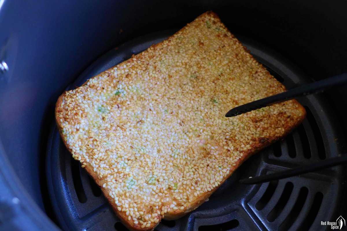 A piece of sesame shrimp toast in an air fryer