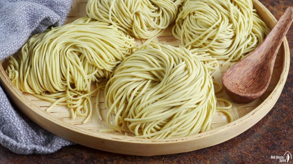 fresh homemade alkaline noodles on a tray