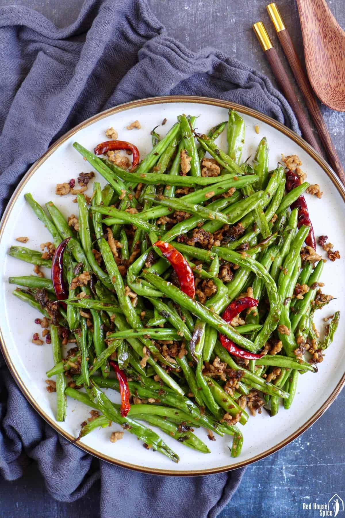 Sichuan dry fried green beans on a plate