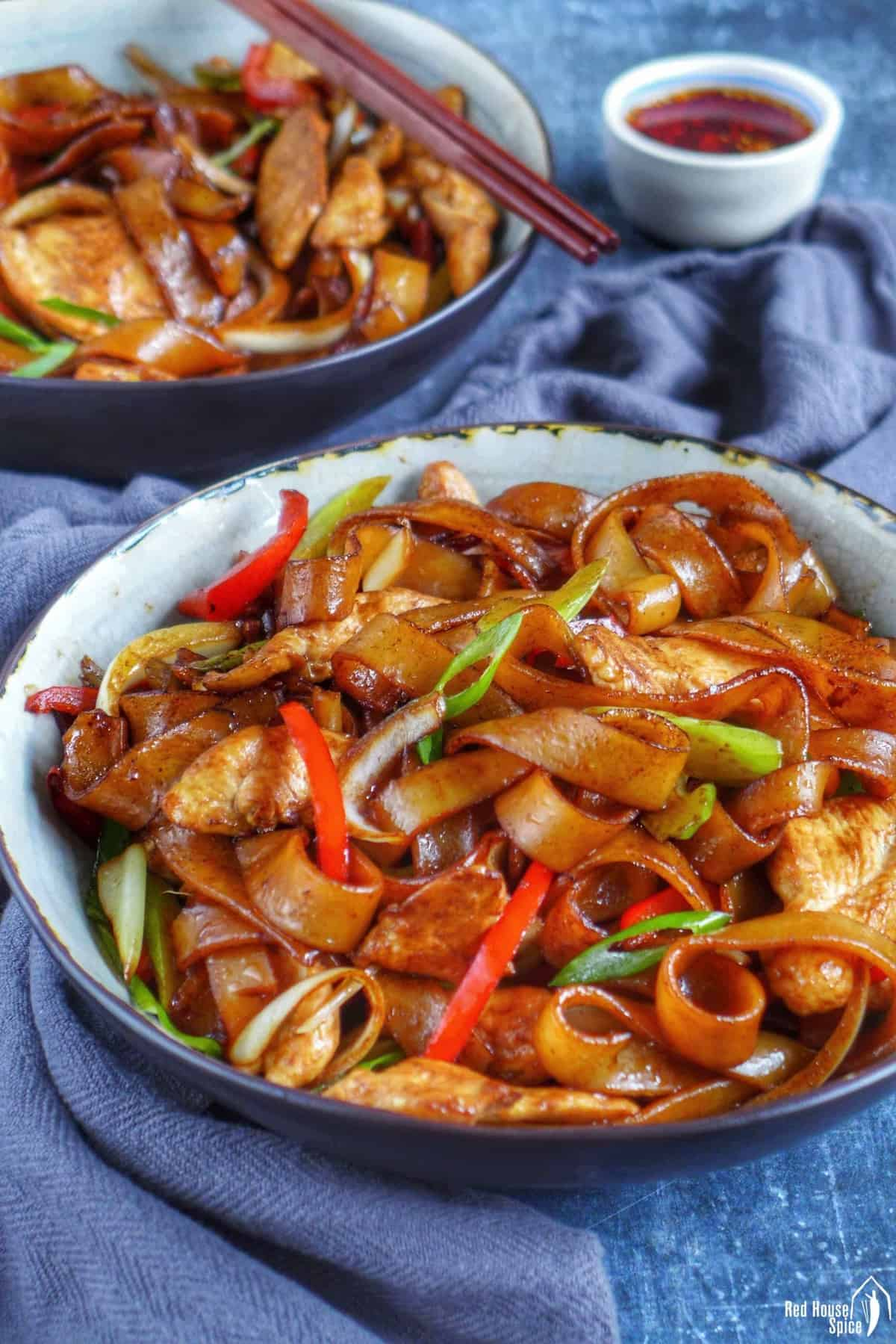 chicken chow fun in a bowl