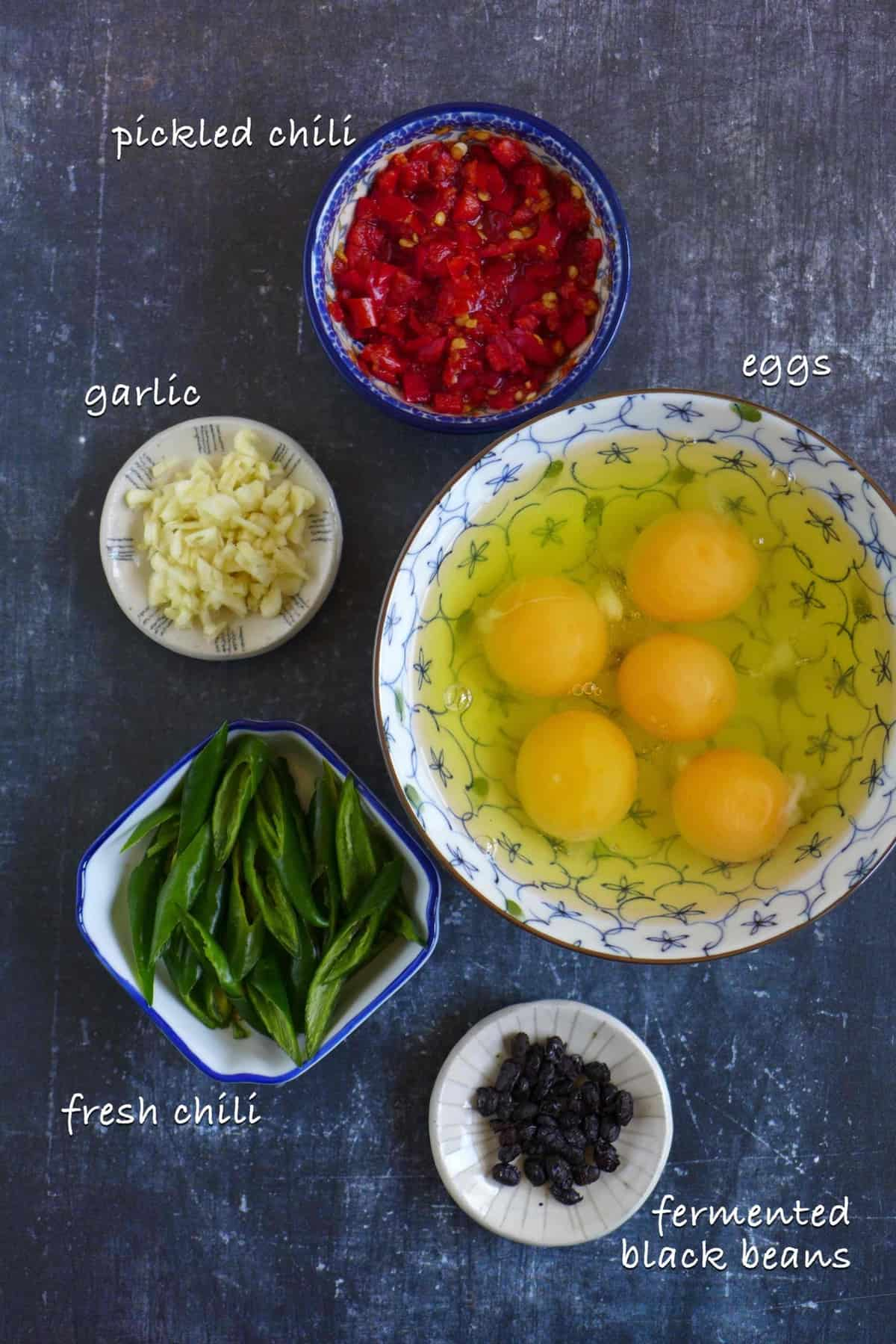 Raw ingredients for making egg and pickled chili stir-fry