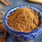 Homemade Chinese five spice powder in a bowl with overlay text that says homemade five-spice.