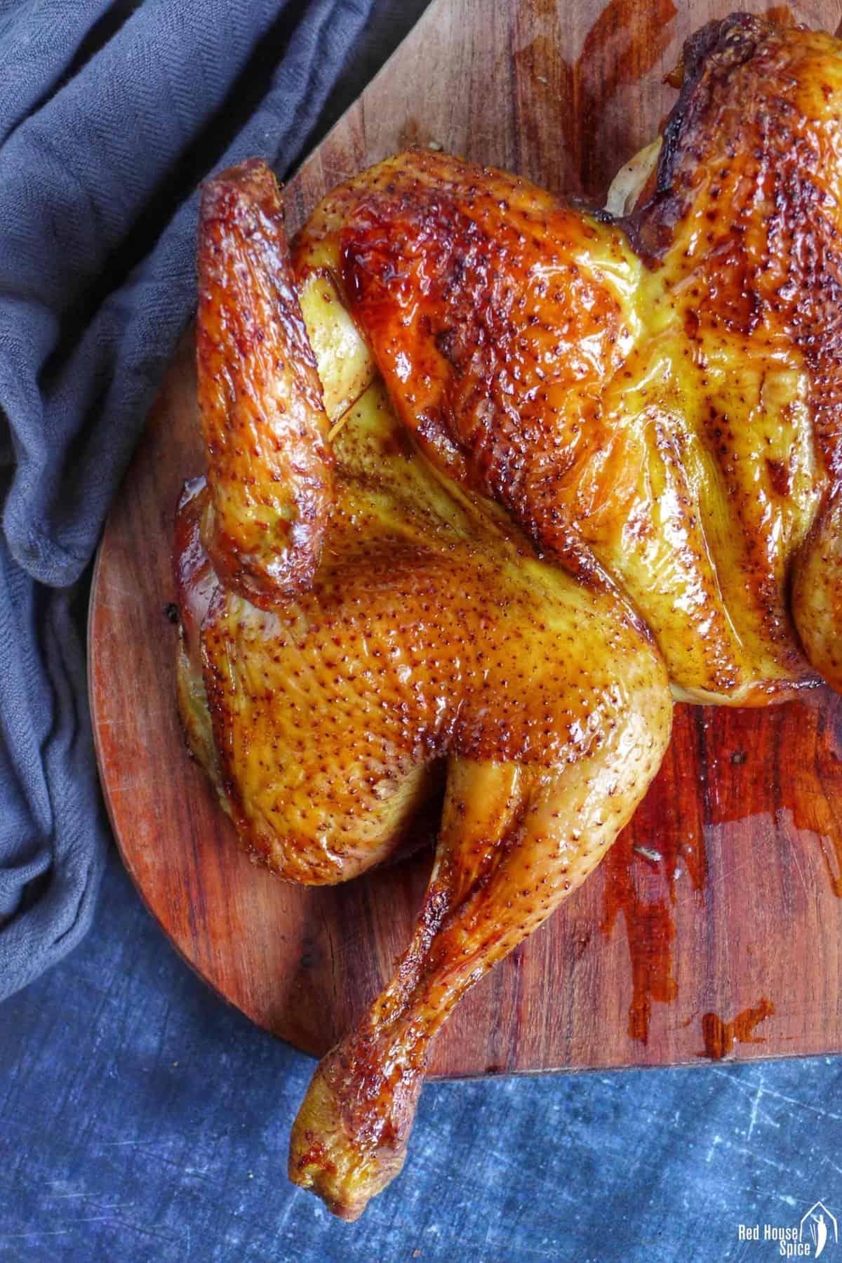 roast chicken on a chopping board