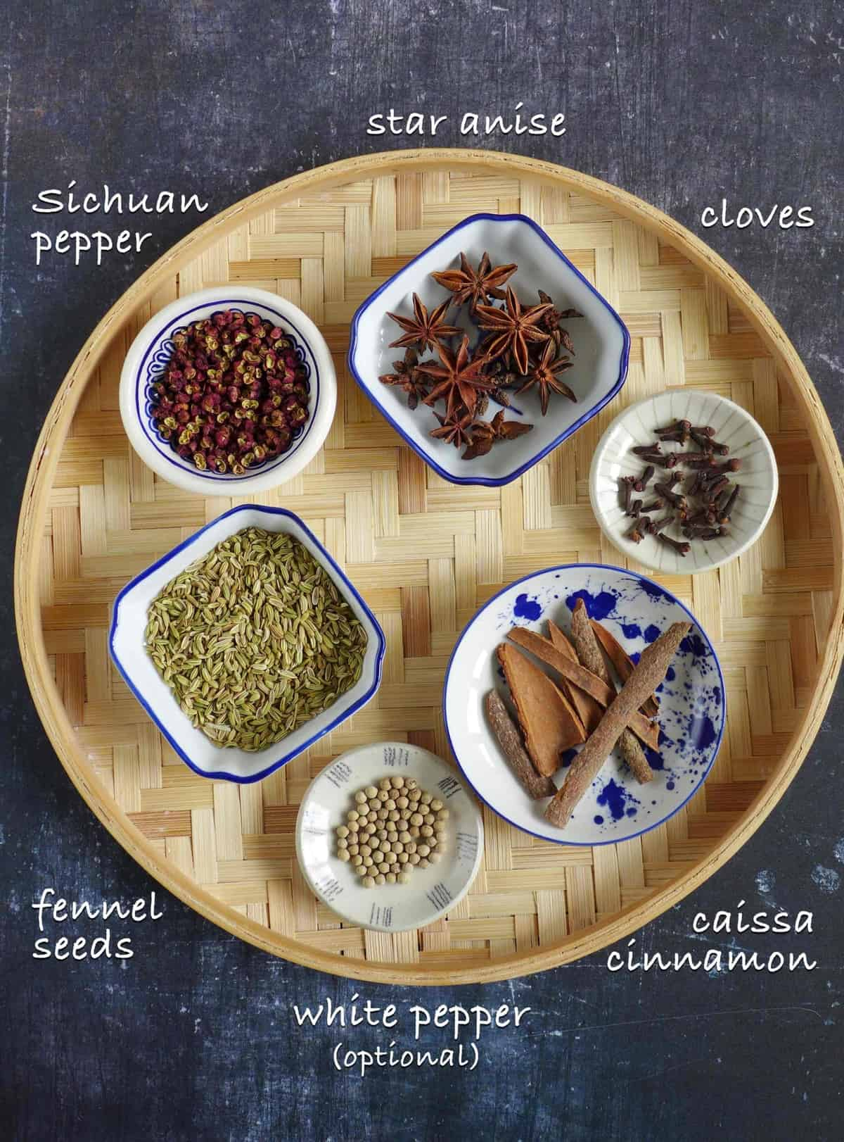 Ingredients for making five spice powder: fennel seeds, star anise, cloves, Sichuan pepper, cassia cinnamon and white pepper.