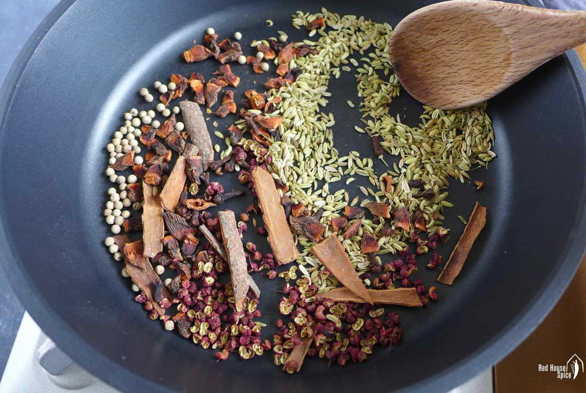 Toasting spices in a pan.