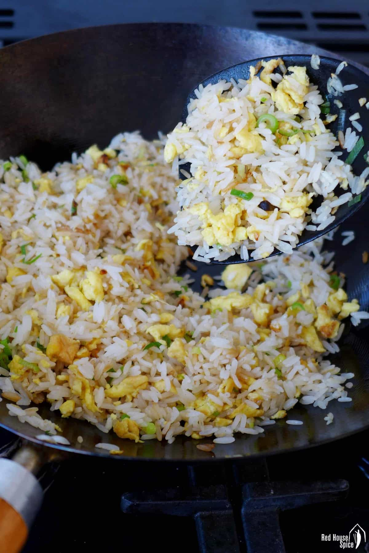 Frying egg and rice in a wok.